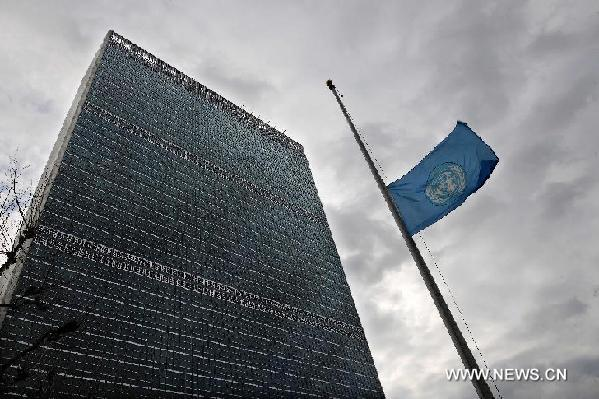 The United Nations flies its blue and white flag at half-mast to mourn the death of Kim Jong Il, the late leader of the Democratic People's Republic of Korea (DPRK), at the UN Headquarters in New York, the United States, Dec. 28, 2011. [Shen Hong/Xinhua]
