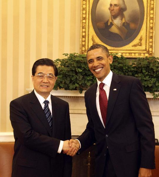 Chinese President Hu Jintao shakes hands with U.S. President Barack Obama during a bilateral meeting at the White House in Washington, the United States, Jan. 19, 2011. [Lan HongguangXinhua]