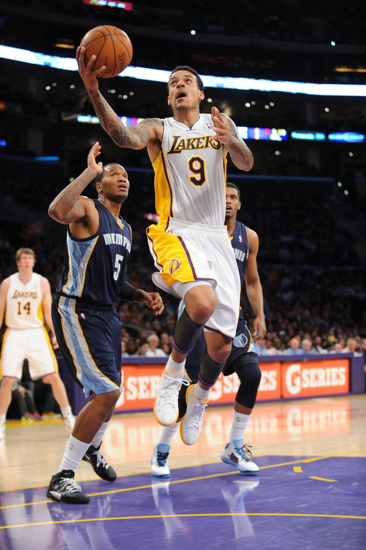 Los Angeles Lakers forward Matt Barnes puts up a shot as Memphis Grizzlies center Marc Gasol of Spain defends during the second half of their NBA basketball game, Sunday, Jan. 8, 2012, in Los Angeles.