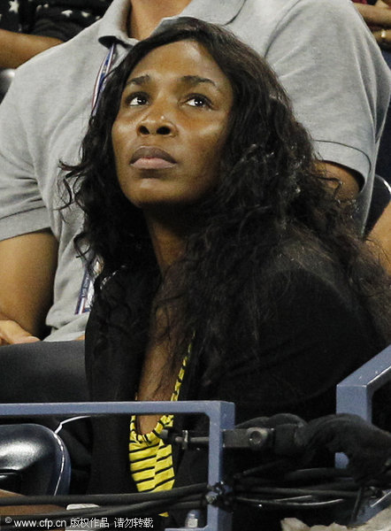 Venus Williams watches her sister Serena during a semifinal match against Caroline Wozniacki of Denmark at the U.S. Open tennis tournament in New York on Saturday, Sept. 10, 2011.