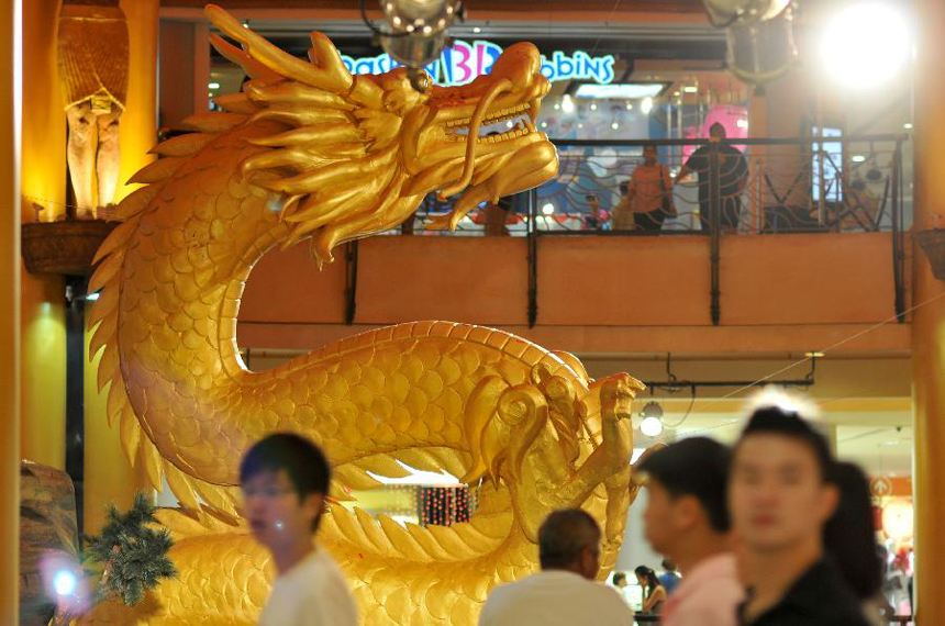 A shopping plaza is decorated with the well-designed dragon statue to celebrate the upcoming Chinese Lunar New Year in Kuala Lumpur, Malaysia, Jan. 16, 2012. Chinese Lunar New year, or the Spring Festival, falls on Jan. 23 this year.