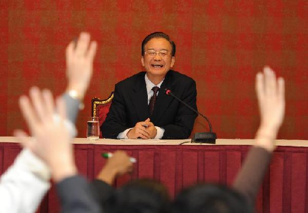 Chinese Premier Wen Jiabao attends a press conference in Doha, capital of Qatar, Jan. 18, 2012. [Photo/Xinhua]