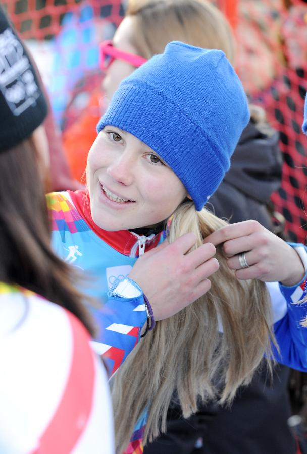 Clara Direz of France fixes up her hair after competing of the women's alpine skiing giant slalom race at the first Winter Youth Olympic Games in Innsbruck, Austria, Jan. 18, 2012. Clara Direz claimed the title of the event with a time of 1:56.13. [Xinhua photo]