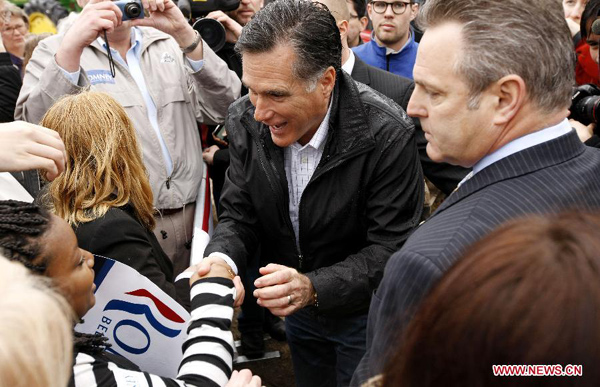 Republican presidential candidate, former Massachusetts Gov. Mitt Romney shakes hands with a little girl after a campaign in Gilbert, South Carolina, Jan. 20, 2012. [Xinhua File Photo]