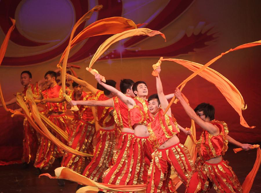 Artists from central China's Hunan Province take part in a performance for celebrating the Chinese Lunar New Year in St. Petersburg, Russia, Jan. 30, 2012.