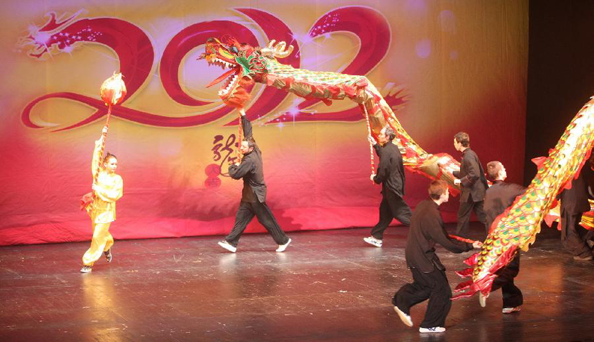 Russian artists take part in a performance for celebrating the Chinese Lunar New Year in St. Petersburg, Russia, Jan. 30, 2012. 