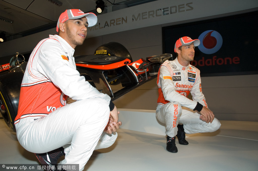 Lewis Hamilton and Jenson Button unveil their new car for the 2012 Formula 1 season at the UK McLaren Factory.