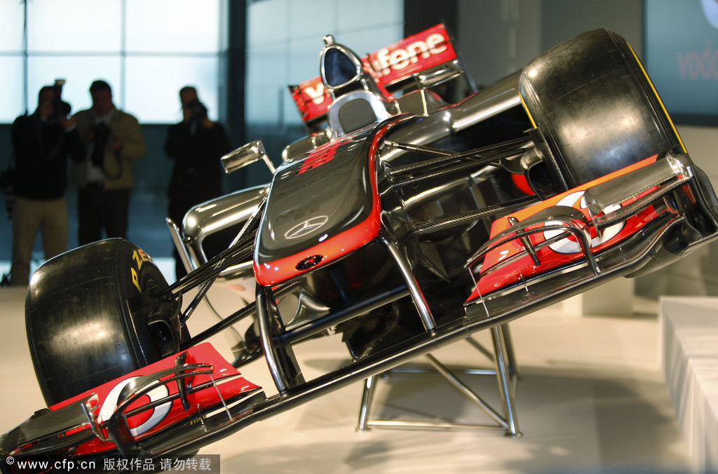 A view of the MP4-27, the newly-unveiled Vodafone Mclaren Mercedes Formula One car for the 2012 season, during a photo-op prior to the launch near woking, England on Wednesday, Feb. 1, 2012.