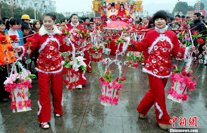 People celebrate the Lantern Festival in Dexing, Jiangxi Province. Monday, the fifteenth day of the first lunar month, is China's traditional Lantern Festival. And the festive atmosphere builds across the country.
