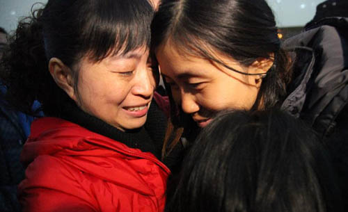 Xia Wenqiong (R), who was just rescued from abduction in Sudan, hugs her relatives in Pengshan County, southwest China's Sichuan Province, Feb. 9, 2012. A total of 47 Chinese were caught in the attack, which occurred in a southern Sudanese state 13 days ago. Twenty-nine of them were abducted by the assailants while the other 18 managed to flee.  [Xinhua]