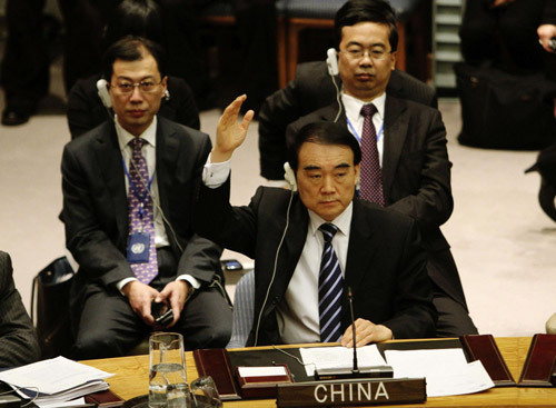 China's Ambassador Li Baodong (front) votes during a UN Security Council meeting on an Arab-European draft resolution on Syria backing an Arab League plan which demands a regime change in the Middle East country, New York February 4, 2012. [Photo/Xinhua]