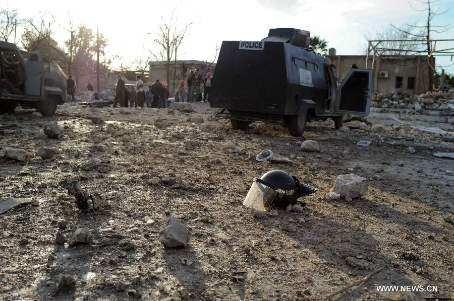 Photo taken on Feb. 10, 2012 shows the explosion site of a law-enforcement force in Hanano area in Aleppo, northern Syria. Twin deadly blasts caused by car bombs hit two sites of Syrian government forces in northern Aleppo province Friday, leaving 28 people killed and other 235 injured, said Syria's official media, blaming the attacks on armed groups backed by foreign plot.