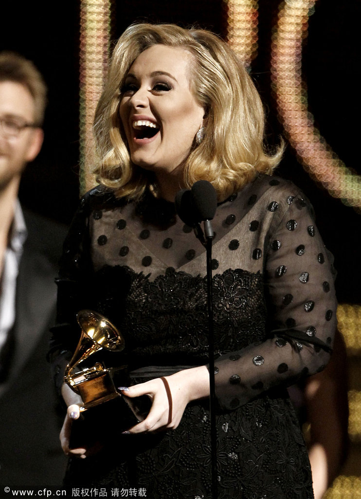 Adele accepts the award for record of the year for 'rolling in the deep' during the 54th Annual Grammy Awards on Sunday, Feb. 12, 2012 in Los Angeles.