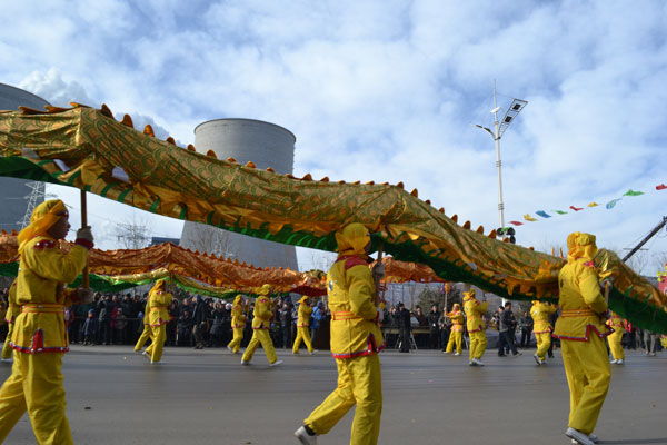 5. Dragon dancers parade through the street for the She Huo Jie festival in Zuoquan, Shanxi Province, Feb. 8, 2012.
