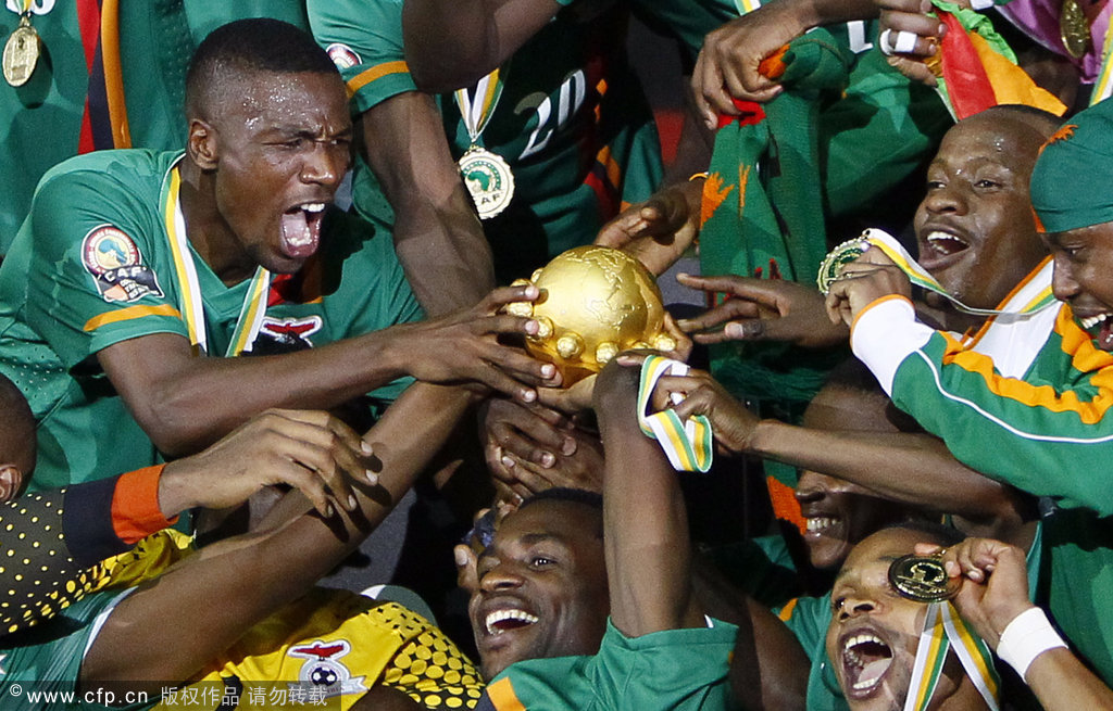 Zambia's players celebrate with the trophy of the African Cup of Nations after winning their final soccer match against Ivory Coast at Stade de I'amitie in Libreville, Gabon, on Sunday, Feb. 12, 2012.