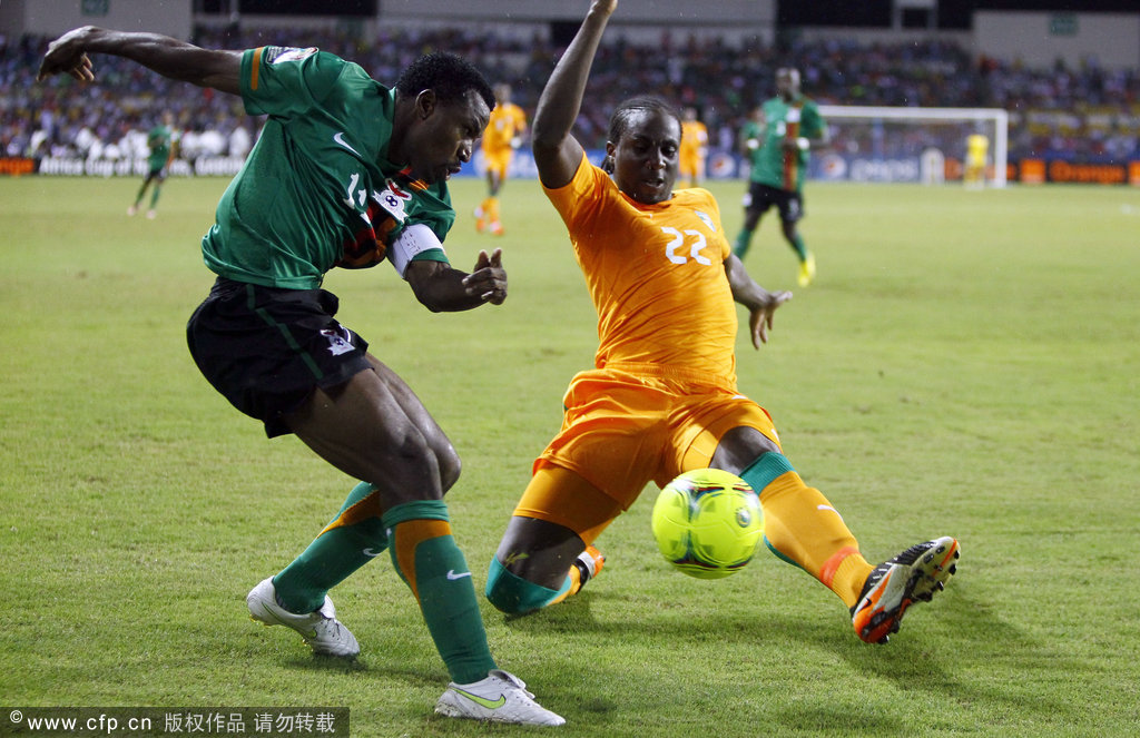 Ivory Coast's Souleymane Bamba (right) is challenged by Zambia's Christopher Katongo during their African Cup of Nations final soccer match at Stade de I'amitie in Libreville, Gabon, on Sunday, Feb. 12, 2012.