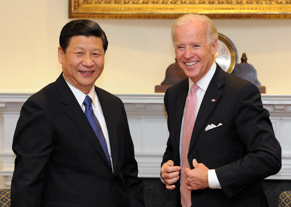 China's Vice-President Xi Jinping (L) meets with U.S. Vice President Joe Biden at the White House in Washington, February 14, 2012. [Xinhua]