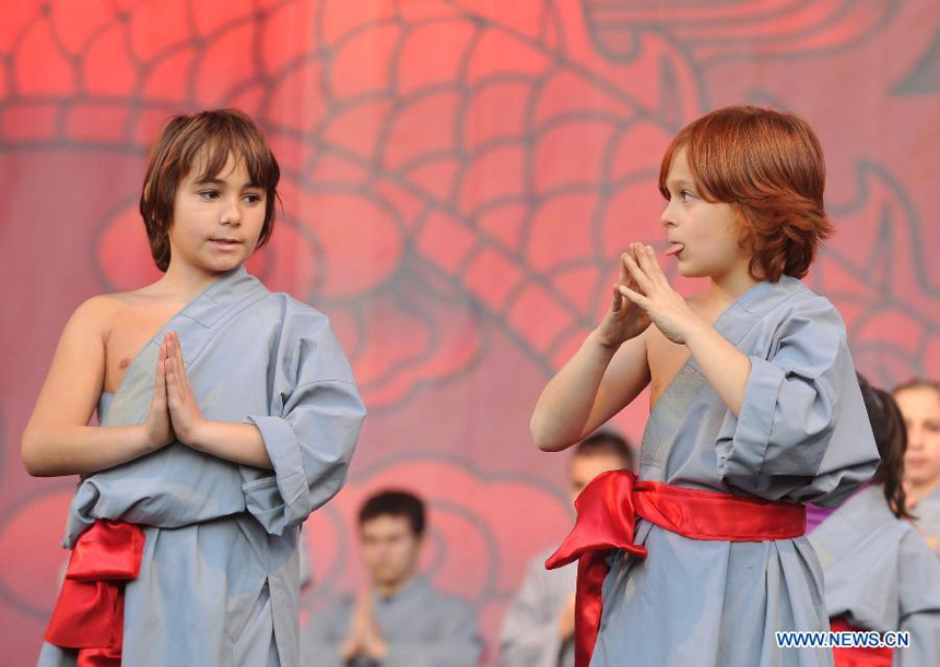 Children of local martial arts association perform Chinese Kungfu at Piazza del Popolo during the closing celebration of the Chinese Culture Year in Italy in downtown Rome, Italy, Jan. 14, 2012. Inaugurated in October 2010, the Chinese Culture Year in Italy has brought nearly 200 events to 12 regions across Italy, boosting cultural exchanges among the two peoples.