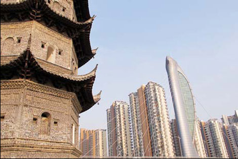 Ancient towers and skyscrapers stand side-by-side in Wuhu, Anhui province. Wang Kaihao / China Daily