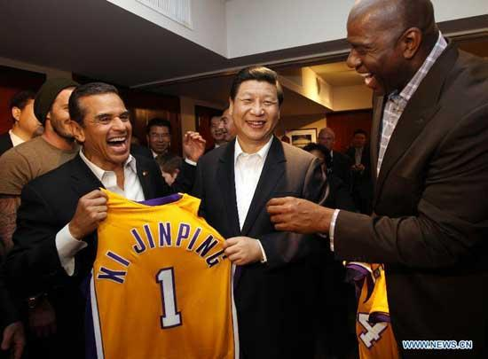 Chinese Vice President Xi Jinping (C, front) is presented with a souvenir Los Angeles Lakers jersey with his name imprinted on it by former Lakers star Magic Johnson (R, front) at the Staples Center in Los Angeles, the United States, Feb. 17, 2012.