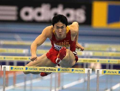 Liu Xiang of China crosses a hurdle during the men's 60m hurdles final at the Birmingham indoor tournament in Birmingham, Feb. 18, 2012. Liu Xiang wins the men's 60m hurdles final at the Birmingham indoor tournament on Saturday. (Xinhua/Yin Gang)