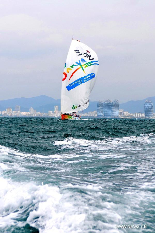 The Chinese Team Sanya yacht sails in the In-Port-Race, which is a part of the Volvo Ocean Race, in Sanya, south China's Hainan Province, Feb. 18, 2012. Sanya yacht took the sixth place of the race Saturday. (Xinhua/Hou Jiansen)