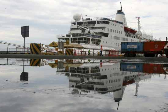 The Logos Hope is reflected on a puddle of water as it docks in Pier 15 in Manila, the Philippines, on Feb. 17, 2012. The Logos Hope is the world's largest floating book fair which displays and sell books in a wide range of subjects such as art, philosophy and technology. (Xinhua/Rouelle Umali)