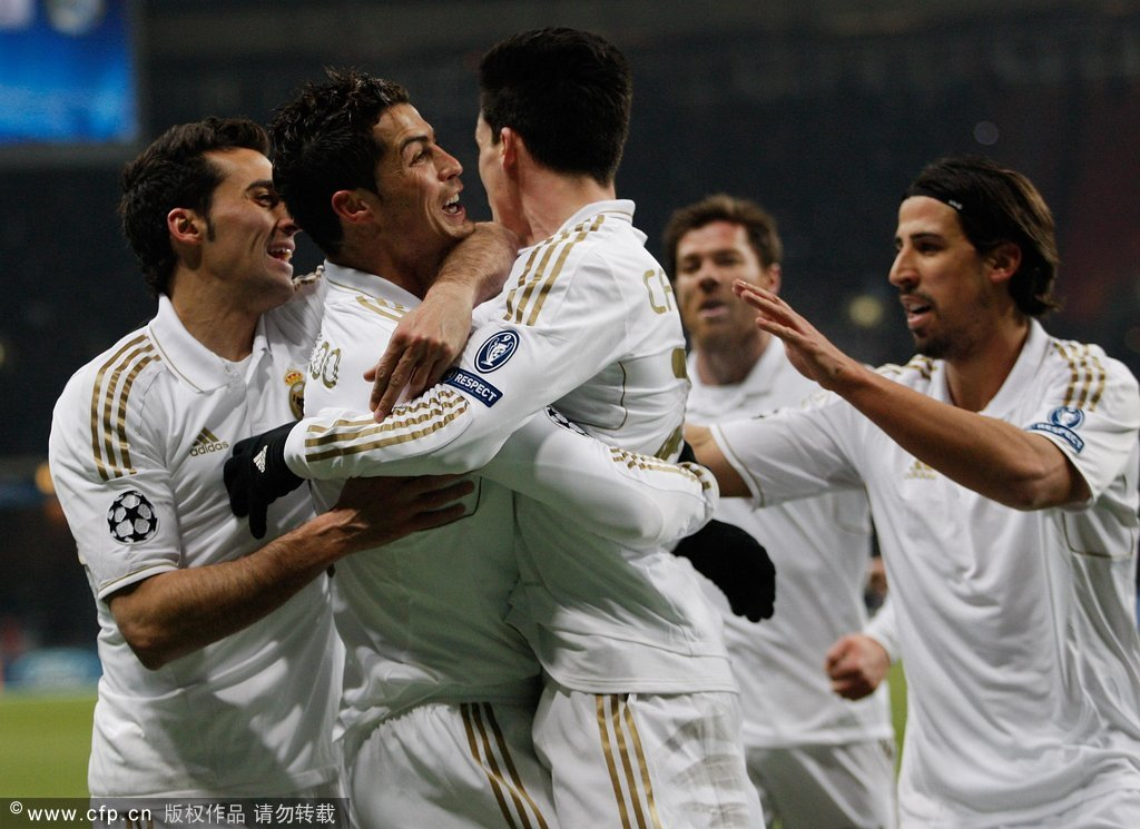Cristiano Ronaldo of Real Madrid celebrates with teammates after scoring the opening goal during the UEFA Champions League round of 16, first leg match between CSKA Moscow and Real Madrid at the Luzhniki Stadium on February 21, 2012 in Moscow, Russia.