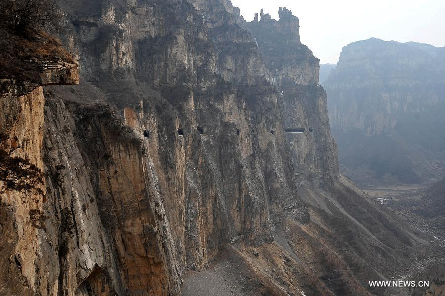 Photo taken on Feb. 24, 2012 shows the 'heavenly road' along the waist of the Taihang Mountains in Pingshun County, north China's Shanxi Province. The 1,526-meter-long road, which spirals up along the 1,100-meter-high Taihang Mountains is a shortcut to the Jingdi Village at the mountain foot. Local villagers spent 15 years to build the road and they call it 'heavenly road.'