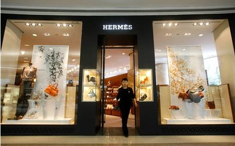 A clerk walks out of a Hermes store. [File photo]