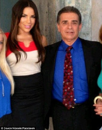 Dr Michael Niccole (R), from Newport Beach, California, gave Brittani (L), now 23, breast implants at 18. [Agencies]