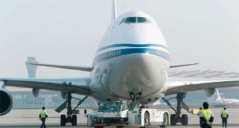 An Air China Ltd plane is fueled with a mixture of jet fuel and biofuel in Beijing. The market value of Chinese aviation biofuel will exceed 120 billion yuan ($19 billion) by 2020 and 30 percent of the country's jet fuel will come from biofuel by then. [China Daily]