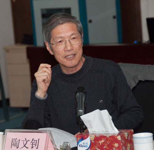 Tao Wenzhao delivers a speech at the seminar organized by China.org.cn on Feb, 23. [Photo: Chen Boyuan/China.org.cn]