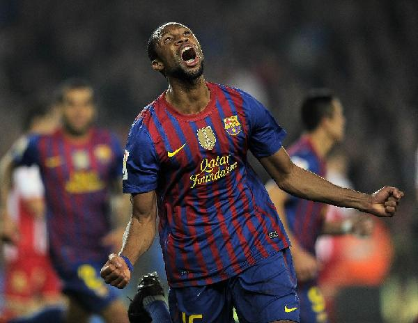 A player of FC Barcelona celebrates after scoring in a game with Sporting Gijon, March, 3, 2012. FC Barcelona defeated Sporting Gijon 3-1 in the Camp Nou. [Xinhua/AFP Photo]
