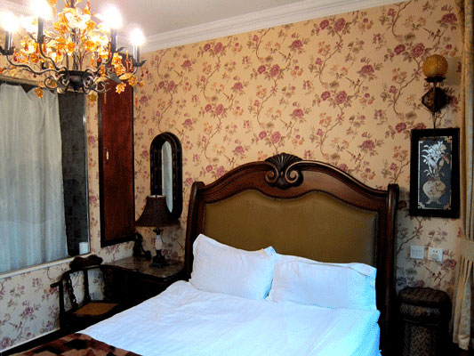 Western style bedrooms at Kelly's Courtyard. Photo by CRI's William Wang, taken February, 2012.