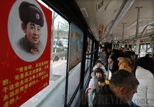 A bus decorated with Lei Feng's portrait and quotes in Zhengzhou, Henan Province [Li Bo]