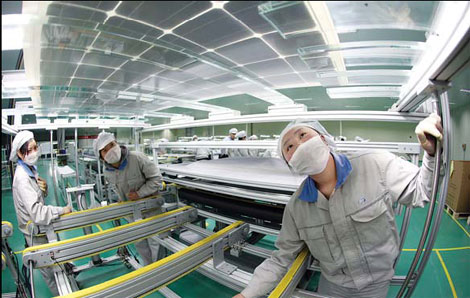 Workers in Lianyungang city, Jiangsu province, make solar panels for export to the US and Europe. Officials say it's likely the EU will investigate claims against Chinese makers of solar products. [China Daily]