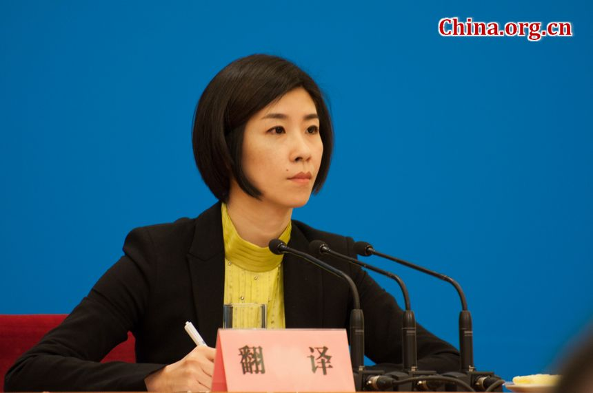 Zhang Lu, a chief interpreter with China&#38;apos;s Ministry of Foreign Affairs, serves the on spot interpreter at Foreign Minister Yang Jiechi&#38;apos;s press conference. Zhang Lu&#38;apos;s quick wit, adroitness, and elegance have all made her a famous figure amongst the public in China. [China.org.cn]
