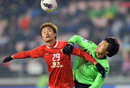 China's Guangzhou Evergrande forward Gao Lin (left) vies for the ball with South Korea's Jeonbuk Hyundai Motors defender Park Won-jae (right) during their Group H AFC Champions League in Jeonju ,South Korea.