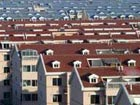 China to continue efforts to build more low income homes