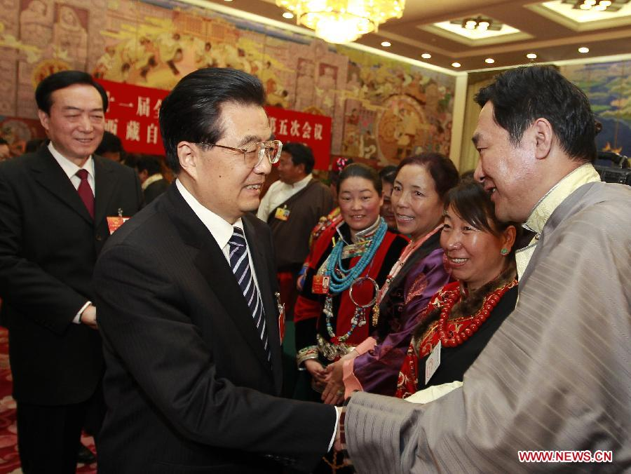 Chinese President Hu Jintao (L, front), who is also General Secretary of the Central Committee of the Communist Party of China (CPC) and Chairman of the Central Military Commission, visits deputies to the Fifth Session of the 11th National People's Congress (NPC) from southwest China's Tibet Autonomous Region and joins their panel discussion in Beijing, capital of China, March 9, 2012. (Xinhua/Ju Peng)