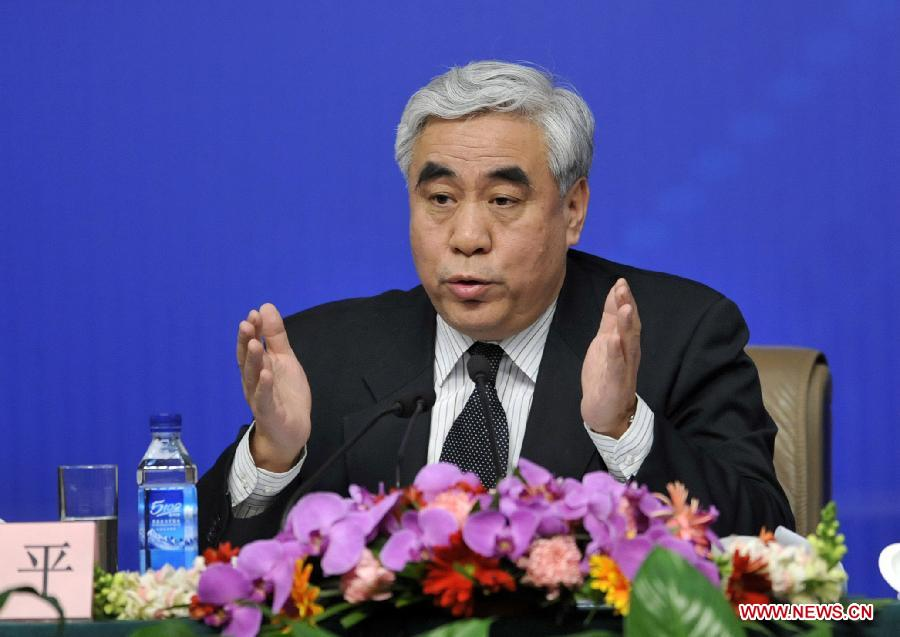 Zhao Ping, a member of the 11th National Committee of the Chinese People's Political Consultative Conference (CPPCC) answers questions from journalists during a news conference of the Fifth Session of the 11th CPPCC National Committee on the reform of medical, health care services in Beijing, capital of China, March 10, 2012. (Xinhua/Wang Peng) 