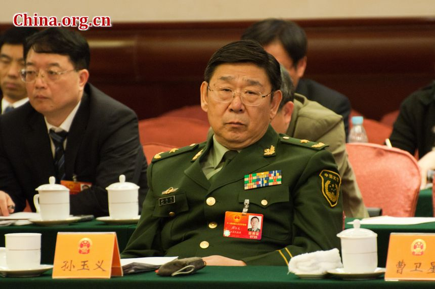 Sun Yuyi, Major General of China's armed police force, and Jiangsu Province's delegate to the country's 11th National People's Congress, attends the provincial panel meeting on Monday, March 12, 2012 in Beijing. During which he has noted the positive roles played by the armed police force, such as disaster relief and maintaining internal stability. [China.org.cn]