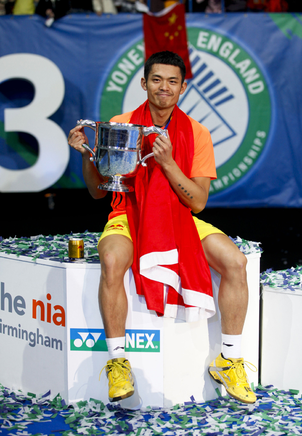 Lin Dan of China holds the trophy on March 11, 2012 following his victory over Lee Chon Wei of Malaysia during the men's singles final of the All-England Open badminton championships at the National Indoor Arena in Birmingham.