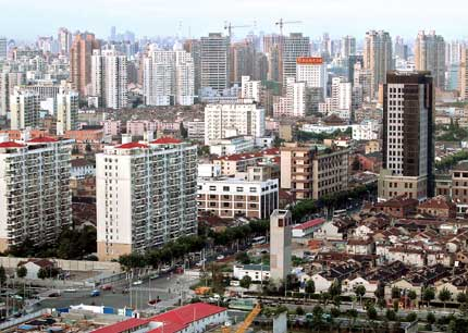 Residential buildings are seen in downtown Shanghai. The sales and supply of new residential properties in the city declined last week, snapping a five-week rally. [Shanghai Daily]