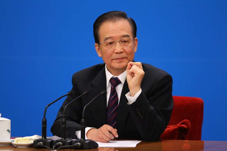 Chinese Premier Wen Jiabao meets the press after the closing meeting of the Fifth Session of the 11th National People's Congress (NPC) at the Great Hall of the People in Beijing, March 14, 2011. In the photo a reporter from Taiwan asks questions.