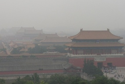 Heavy fog shrouds Beijing's Palace Museum.