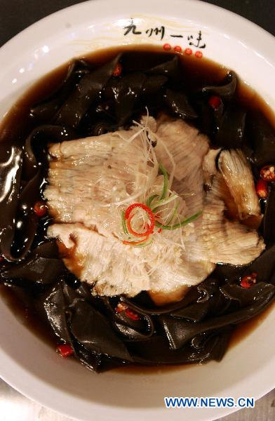 File photo taken on Sept 26, 2010 shows a kind of Sichuan Cuisine dish in Chengdu, southwest China's Sichuan province.[Photo/Xinhua]