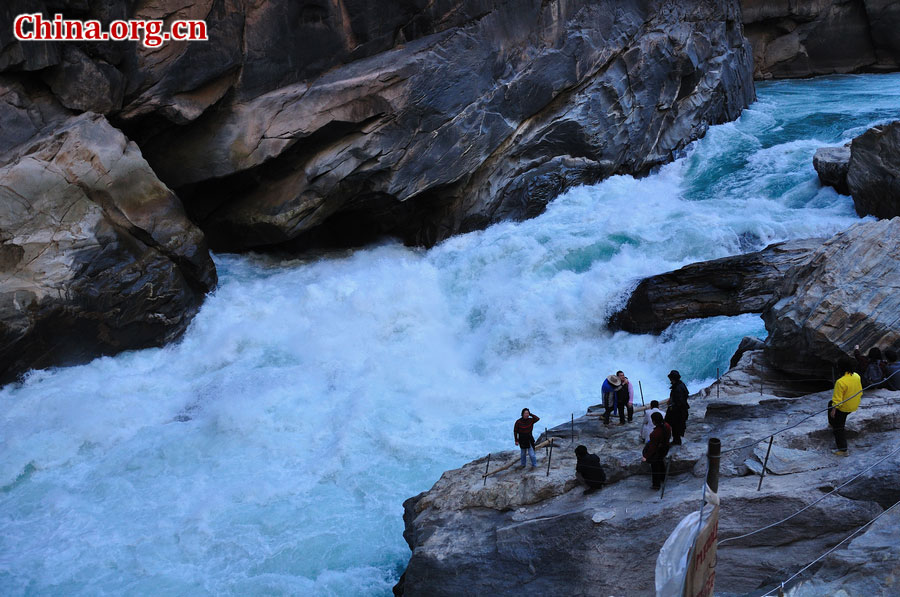 Hutiao Gorge is located on the upper reaches of the Jinsha River, to the northeast of Lijiang, in southwest China's Yunnan Province. The narrowest stretch in the river is only about 30 meters across and carries the legend that a tiger could easily jump across the river. The river is about 29 km long, reaching 3,790 meters in depth between Jade Dragon and Haba Snow Mountains, creating one of the most spectacularly deep gorges in the world. [China.org.cn]