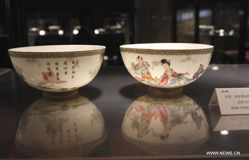 Photo taken on March 21, 2012 shows a set of chinaware displayed during the preview of the 29th China Guardian Quarterly Auction in Beijing. The three-day quarterly auction will kick off here on March 24, following a three-day preview that started on Wednesday. The preview exhibits some 2,600 Chinese painting and calligraphy works, 1,800 pieces of chinaware, furniture and craftwork, as well as 680 rare books and manuscripts.